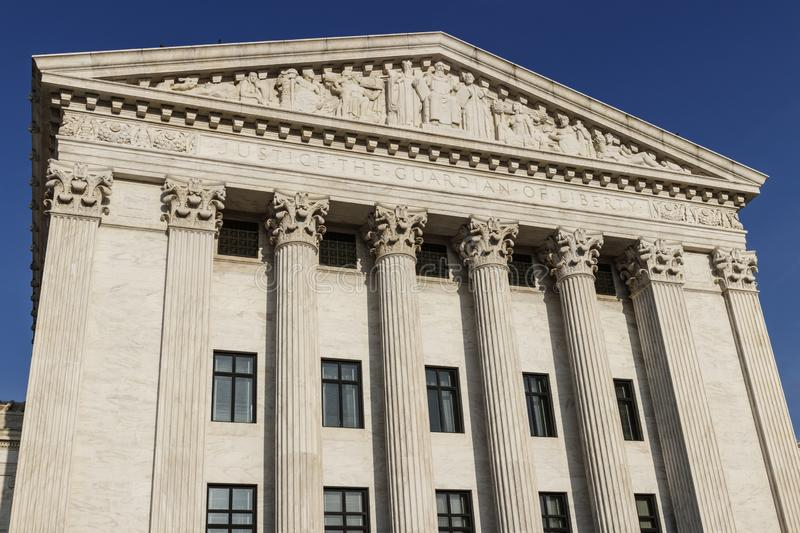Supreme Court of the United States rear facade. Justice The Guardian Of Liberty is printed below the cornice I. Supreme Court of the United States rear facade royalty free stock photo