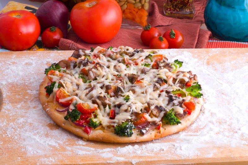 Supreme Pizza. And red tomato stock image