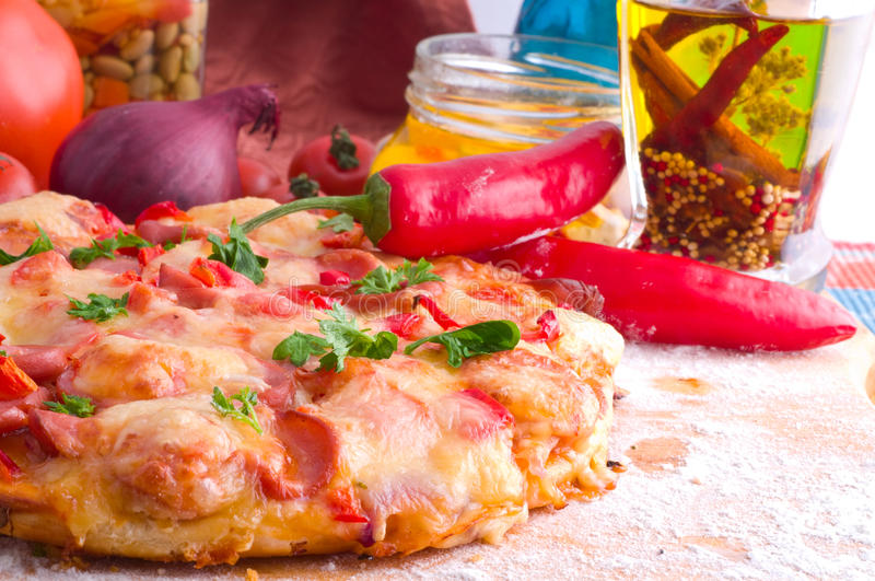 Supreme Pizza. And red tomato royalty free stock images