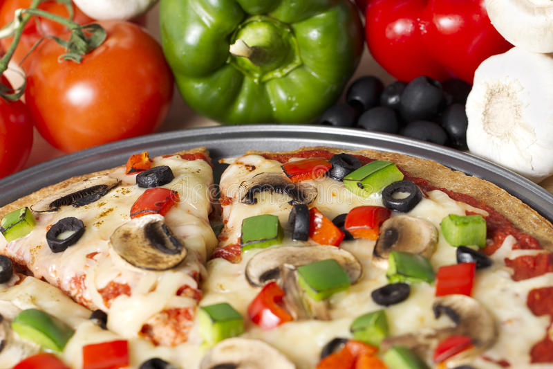 Supreme pizza. Cropped image of supreme pizza royalty free stock photo