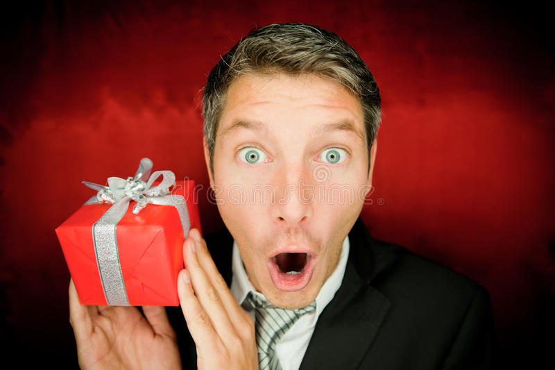 Suprise man with gift stock images