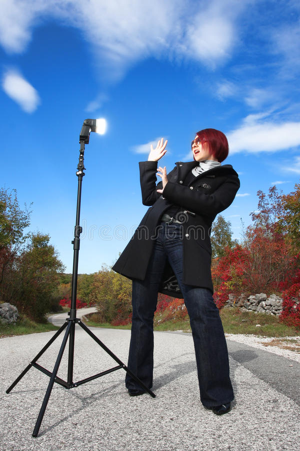 Download Suprised Woman In Front Of Flash Light Stock Photography - Image: 11539422