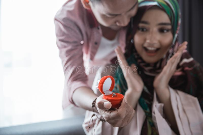 Muslim woman get a ring stock photo