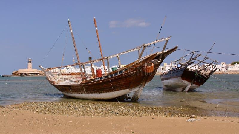 SUR, OMAN: Dhows traditional sailing and fishing boats at the Old Harbor in Ayjah. Dhows traditional sailing and fishing boats at the Old Harbor in Ayjah royalty free stock images