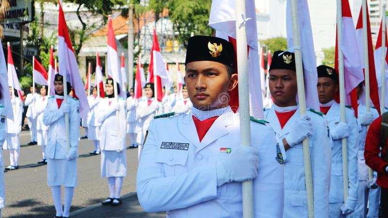 Surabaya-indonesia. November 9 2019. Portrait of young asian male holding indonesia flag royalty free stock photo