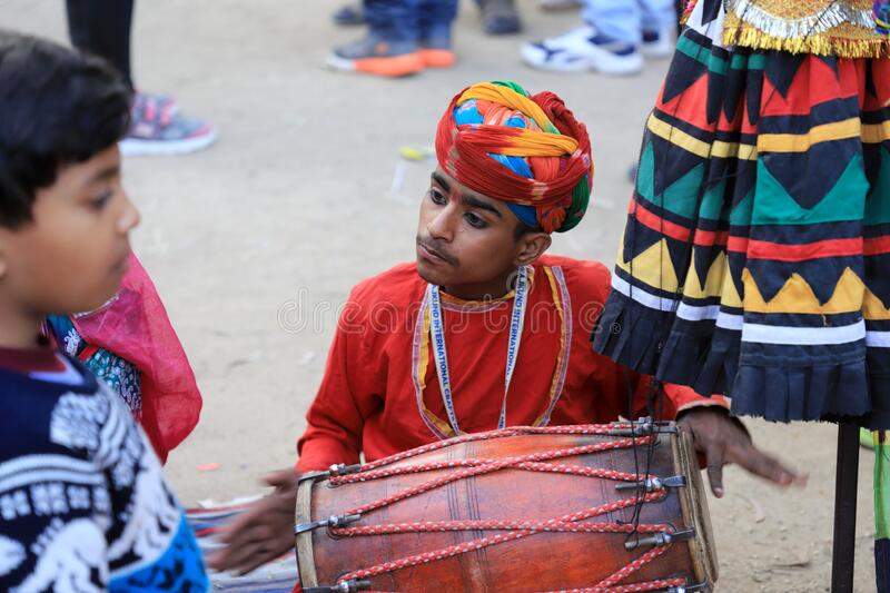 Surajkund, Faridabad, Haryana, India - February 14, 2020 - Indian Musician Child Dholak Player during the 34th Surajkund. International Crafts Mela. The royalty free stock image