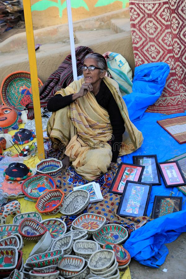 Surajkund, Faridabad, Haryana, India - February 14, 2020 - Old woman selling Indian traditional items during the 34th Surajkund. International Crafts Mela. The stock photos