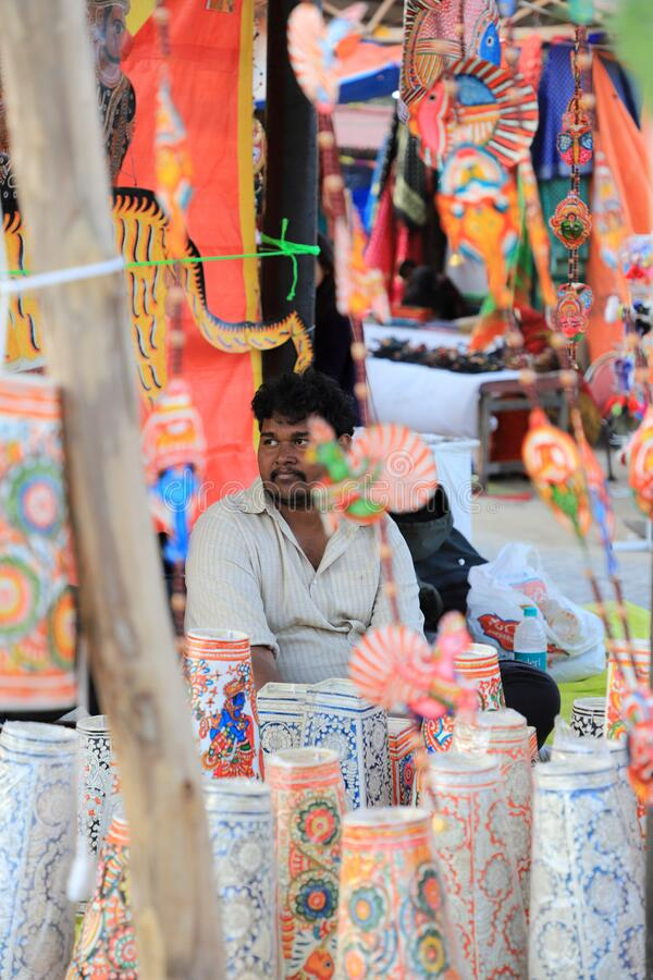 Surajkund, Faridabad, Haryana, India - February 14, 2020 - Seller with paper items during the 34th Surajkund International Crafts. Mela. The festival has over 1 stock images
