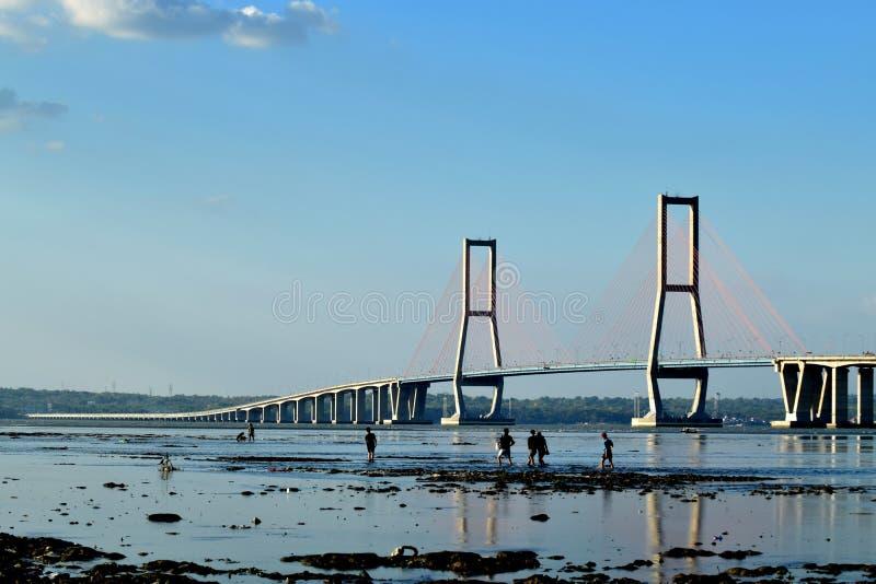 Suramadu bridge Surabaya Indonesia. Suramadu bridge in Surabya, Indonesia with water, dry stock images