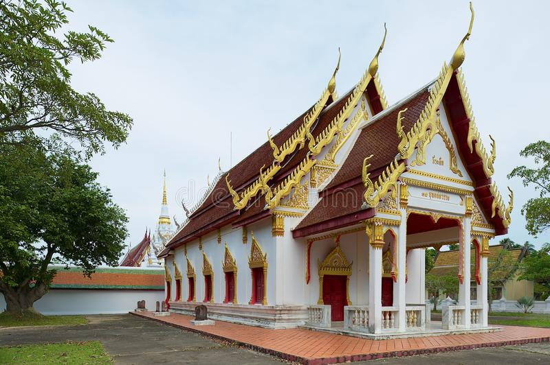 Ubosot and Chedi at Wat Phra Borommathat Chaiya Temple in Surat Thani, Thailand. stock photo