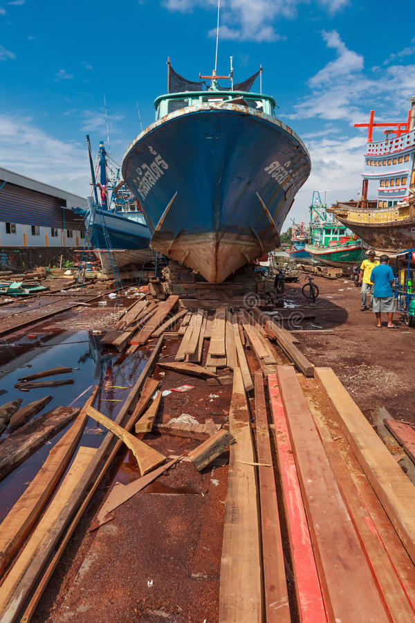 Surat Thani, Thailand - January 15, 2015: Workers and Fishing bo. At at shipyard, Surat thani THAILAND on January 15. -( Selective Focus royalty free stock photo