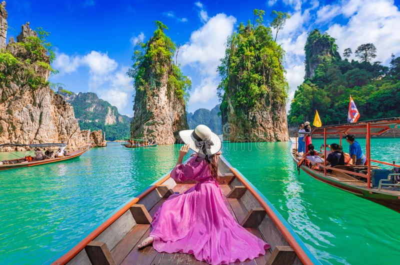 SURATTHANI,THAILAND-JULY 14,2019:Asian woman posing on boat in Ratchaprapha dam Khao sok national park at suratthani,Thailand.  royalty free stock photography