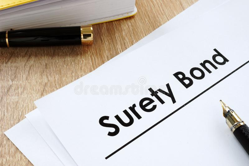 Surety bond form on a table. royalty free stock images