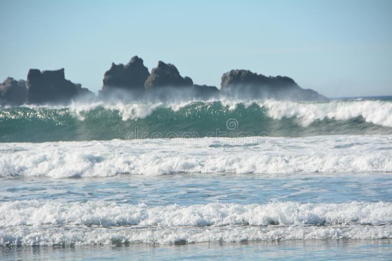 Surf on the beach at Bandon, Oregon. Rows of waves hit the beach near Bandon, Oregon on a sunny day stock photos