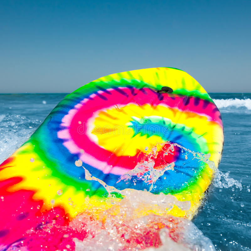Surf board. Colorful surf board with wave splash stock photos