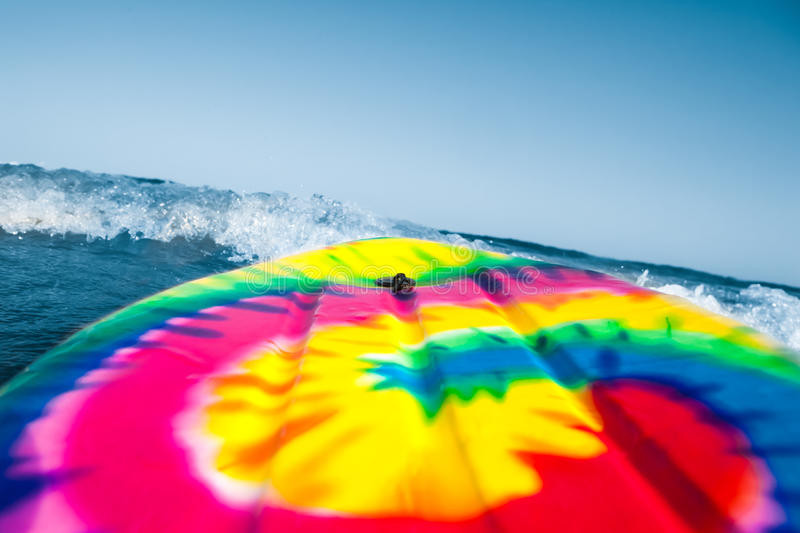 Surf board. Colorful surf board in the blue sea stock photo