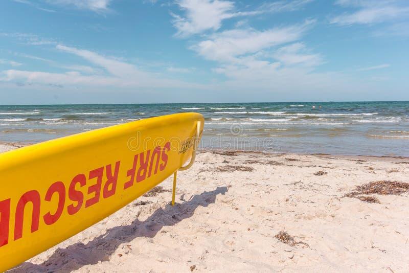 Surf board for the lifeguard on a sunny danish beach close to th. E sea, Rorvig, Denmark, July 20, 2018 stock image