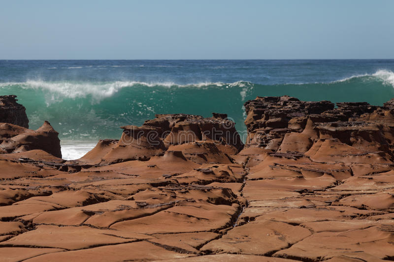 Surf breaking over rocks royalty free stock photo