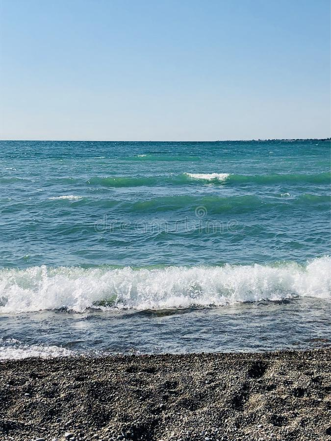 Surf on a bright blue lake. Surf on a turquoise bright blue lake. Lake Ontario at the beaches in Toronto stock image