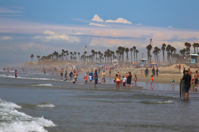 Surf City USA at Huntington Beach. Swimmers and sun bathers gather on the beach at Huntington Beach, Los Angeles, California, United States of America royalty free stock photo