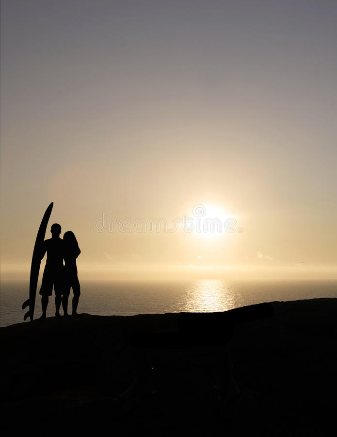 Surf couple at sunset royalty free stock photos