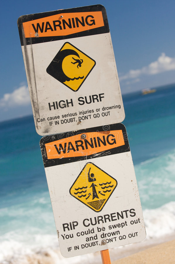 Surf and Currents Warning Sign. On a beach in Hawaii royalty free stock image