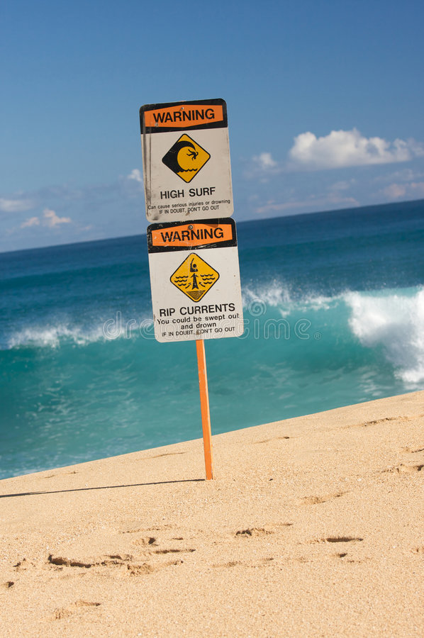 Surf and Currents Warning Sign. On a beach in Hawaii royalty free stock photography