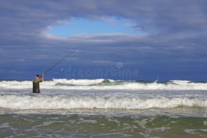 Sea fishing, surf fishing. stock image