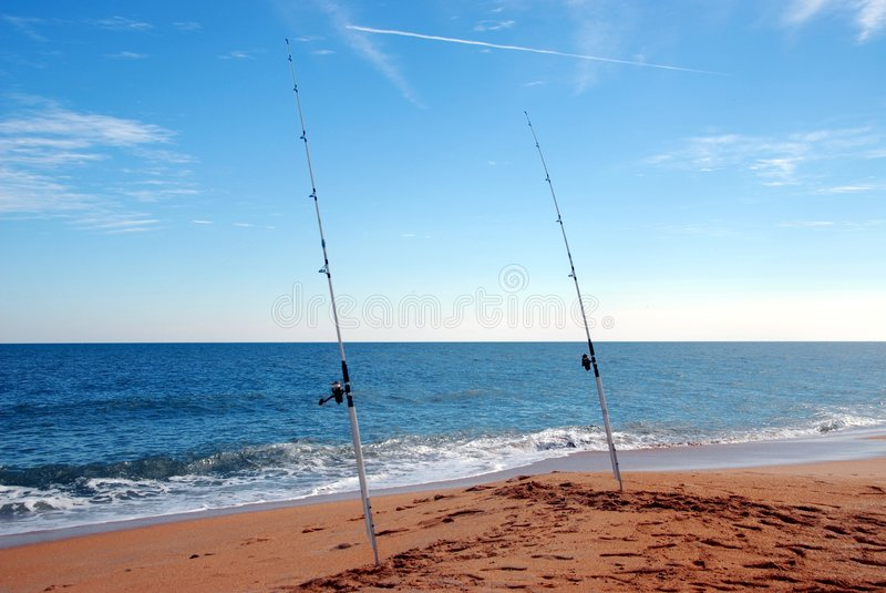 Surf fishing poles. Photographed surf fishing poles on east caost of Florida beach royalty free stock images