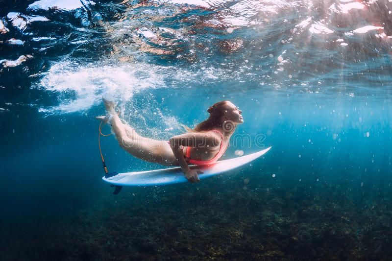 Surf girl dive underwater with wave. Surf girl dive underwater with under wave royalty free stock images