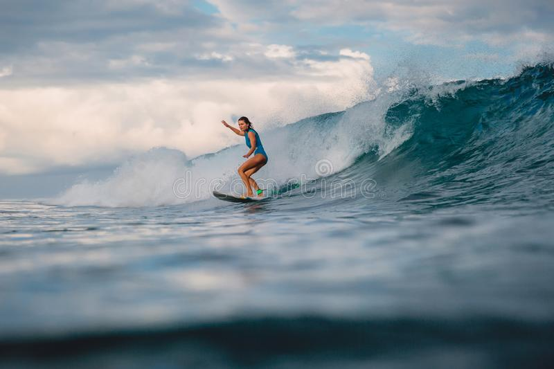 Surf girl on surfboard. Woman in ocean during surfing. Surfer and wave. Beautiful surfer girl on surfboard. Woman in ocean during surfing. Surfer and wave royalty free stock photo