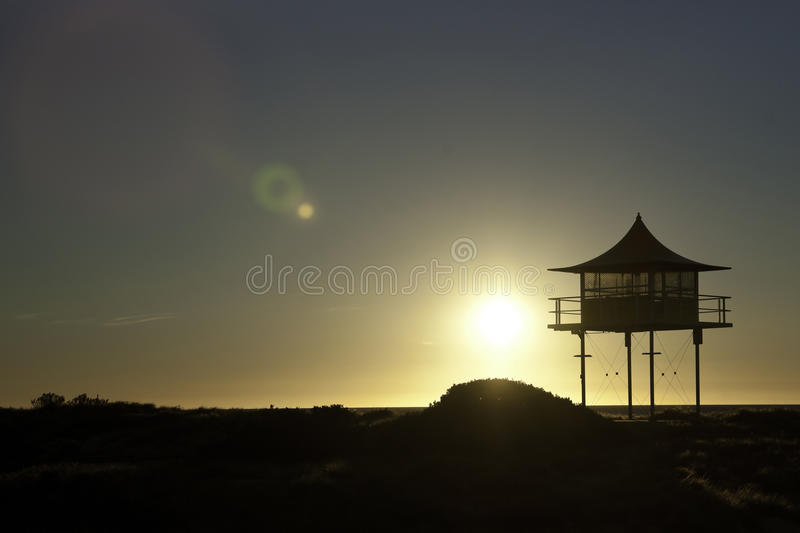 Surf life savers lookout sunset. Sunset behind surf life savers rescue lookout station royalty free stock images