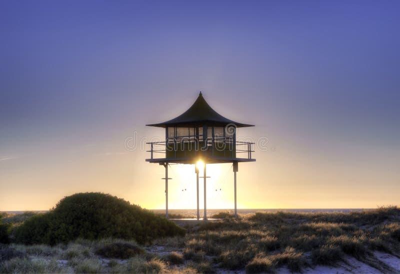 Surf life savers lookout sunset. Sunset behind surf life savers rescue lookout station stock photo