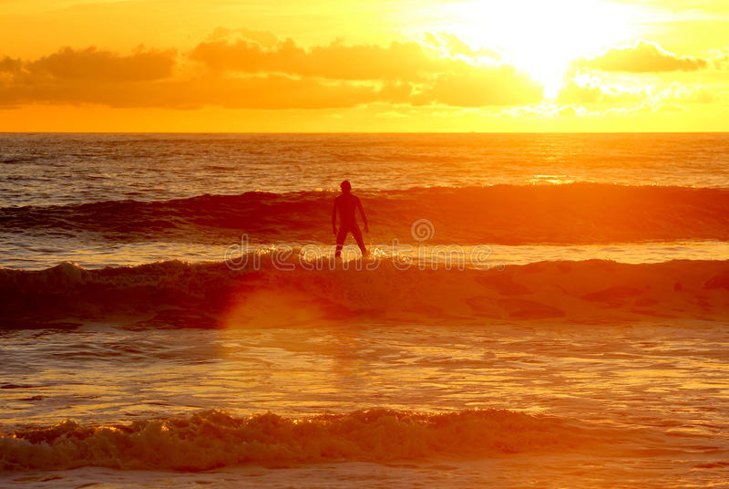 Download Surf Like God - Standing On Water Sunset Stock Image - Image: 28484807