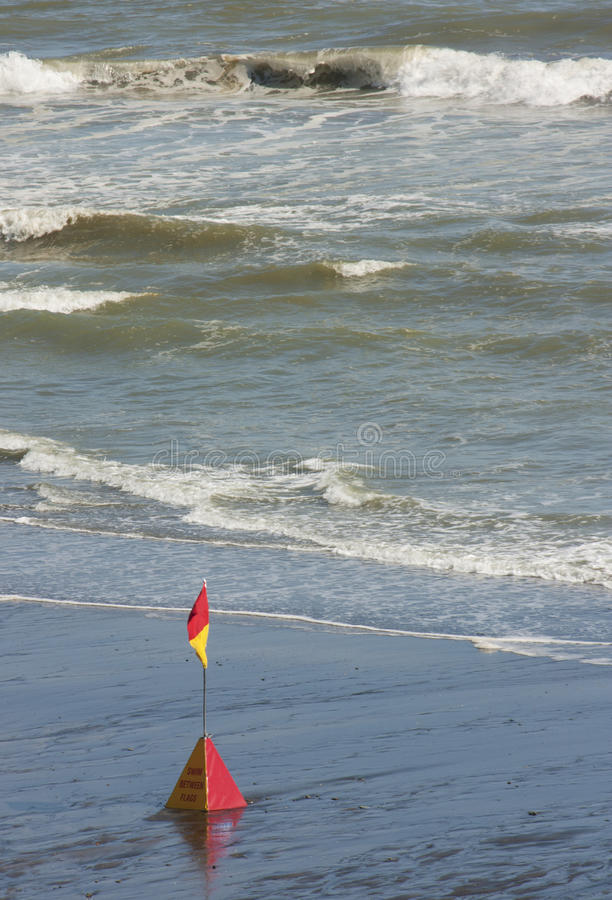 Surf rescue flag stock photo