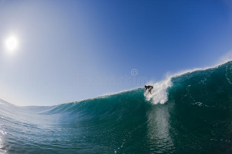 Surfer Catching Wave stock image