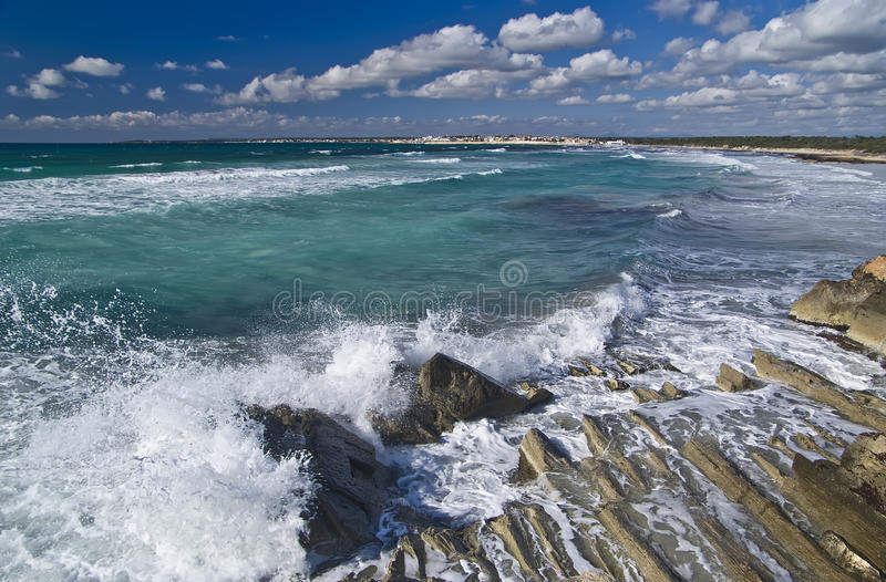 Surf on rock coastline royalty free stock images