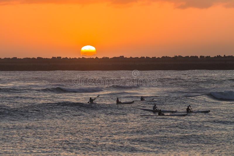 Surf-ski Paddlers Ocean Sunrise stock photography
