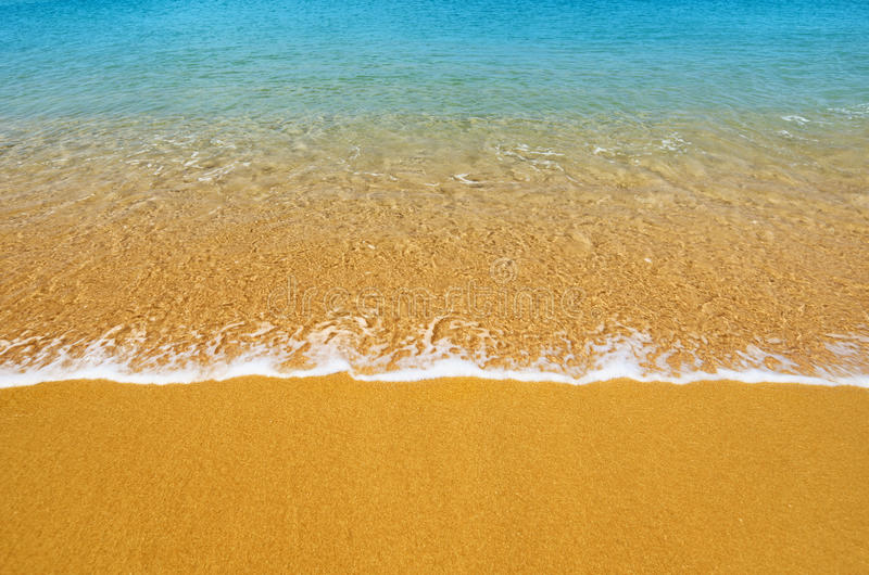 Surf on tropical beach - background. Surf on a tropical beach - summer background royalty free stock photography