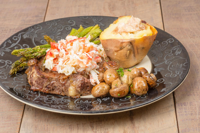 Surf and Turf with Dungeness Crab. A surf and turf meal using beef steak and Dungeness Crab royalty free stock images