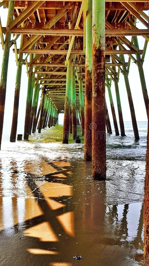 Surf under pier royalty free stock photography