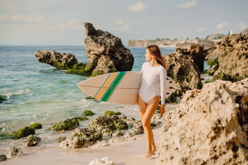 Surf woman with surfboard on beach. Attractive surfer girl. Surf woman with surfboard on beach stock photos