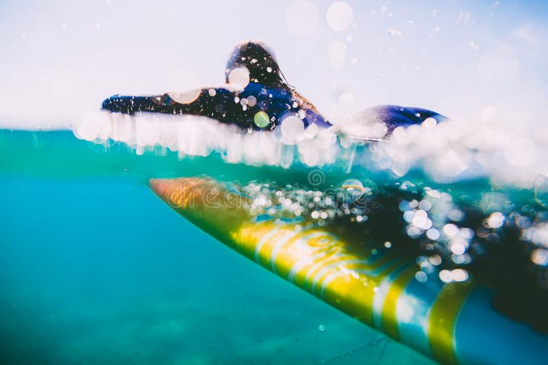 Surf woman on surfboard. Woman with surfboard in ocean during surfing. royalty free stock photography