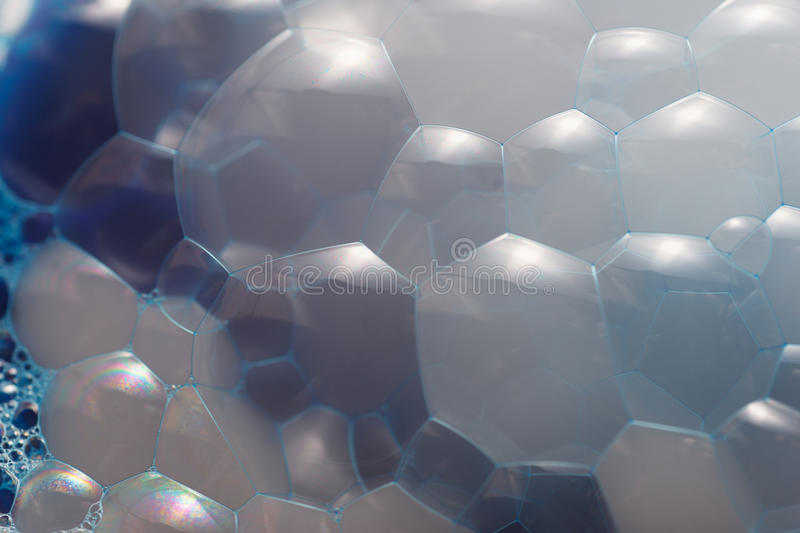 The surface of the bubble. Water surface with blue bubbles abstract background royalty free stock photo