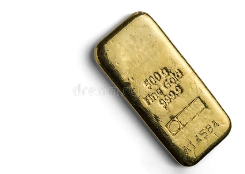 The surface of cast gold bar weighing 500 grams. The texture of the surface of the gold ingot. Isolated on white background royalty free stock images