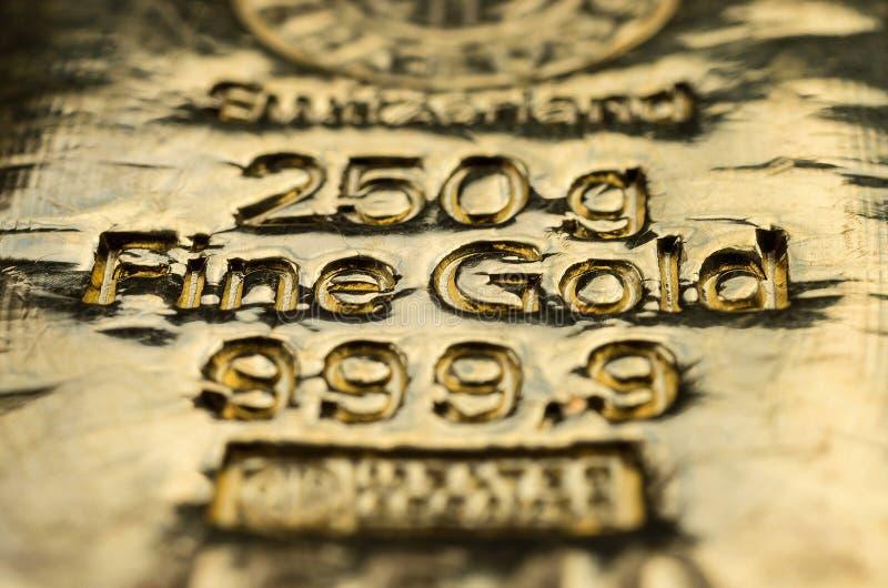 The surface of cast gold bullion. Selective focus. Macro photo. shallow DOF stock photos