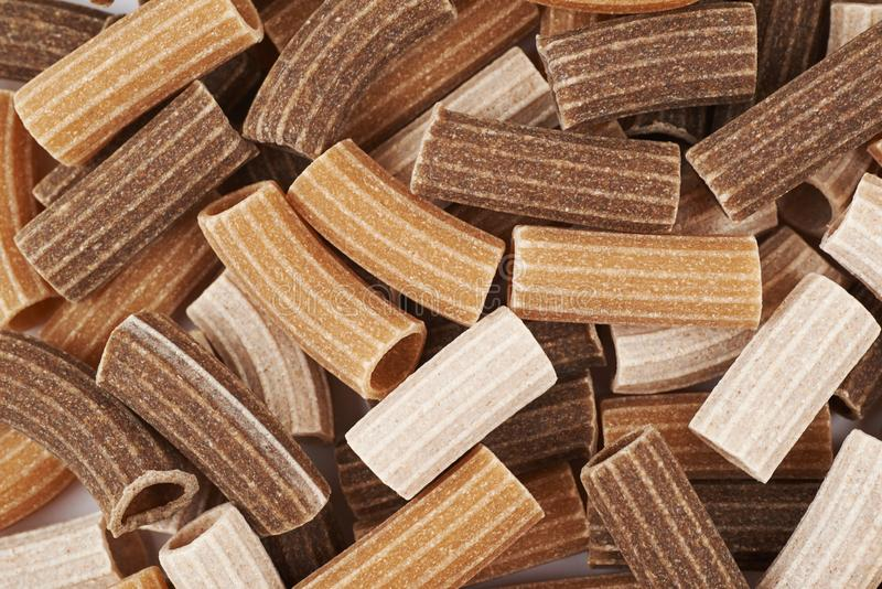 Surface coated with the brown pasta stock images