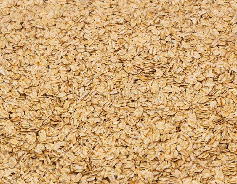 Surface coated with oatmeal flakes as a backdrop texture composition stock photography