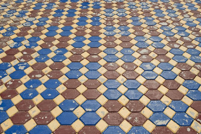 Surface colorful of the old pavement covered with tiles background texture. royalty free stock photography