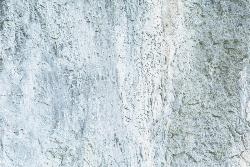 Surface of the cracked stone wall, concrete wall texture stock photos